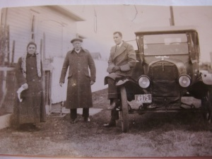 Showing off his new car to his parents outside the house in Ritchie!